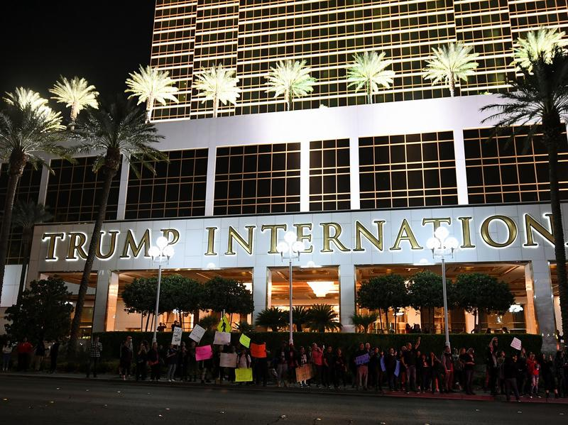 Anti-Donald Trump protesters stand in front of the Trump International Hotel & Tower in Las Vegas Saturday. The new president-elect says he'll follow through on building a wall — and deporting millions of people.