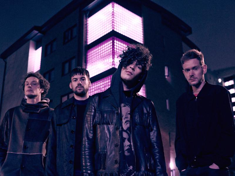 The 1975 is, from left to right, George Daniel, Ross MacDonald, Matty Healy and Adam Hann.