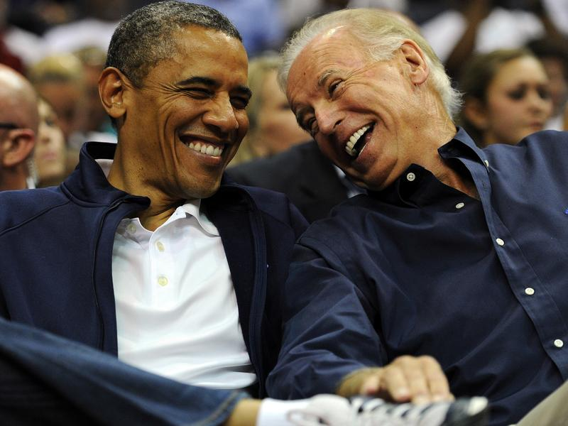President Obama and Vice President Biden watch a basketball game in July 2012 in Washington, DC.