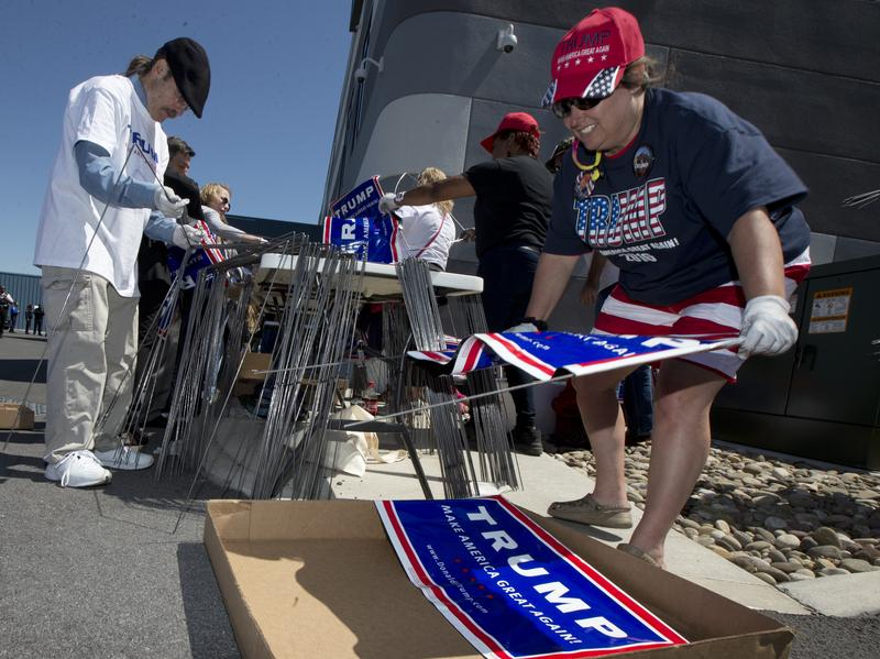 Mary Jo Trapani, a volunteer for Republican presidential candidate Donald Trump, gathers posters for a campaign rally in Hagerstown, Md. The Republican National Committee credits a strong network of local campaign staff and volunteers along with millions of door knocks and phone calls for victory up and down the ballot last week.