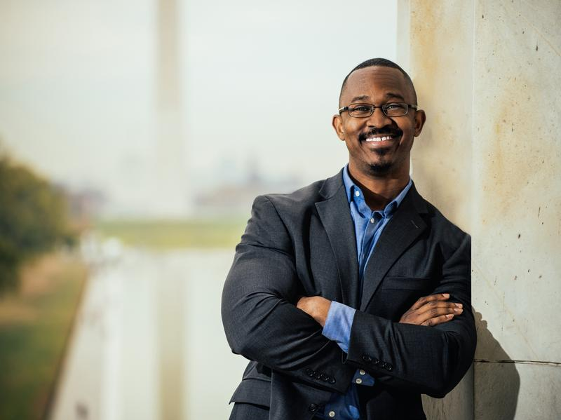 """Joshua Johnson is """"cocreator and host of the provocative nationwide public radio series, <em>Truth Be Told, </em>which explored race in America,"""" member station WAMU wrote in a press release. He will be the host of <em>1A, </em>the new show taking over the time slot currently held by <em>The Diane Rehm Show.</em>"""