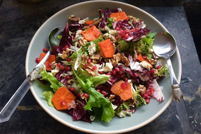 Jessica Battilana's chicory salad with walnuts, blue cheese, persimmons and pomegranates. (Kathy Gunst for Here & Now)