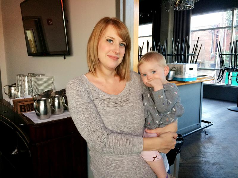 Keely Edgington and her daughter, Lula, pose inside their family-owned restaurant, Julep, in Kansas City, Mo. Lula was diagnosed with a neuroblastoma when she was 9 months old. She's now 16 months old.