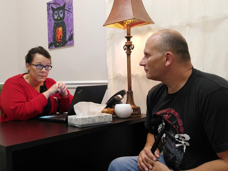 At the Grace Community Health Center in Manchester, Ky., psychologist Joan Nantz meets with patient Ramiro Salazar, who gained Medicaid under the expansion.