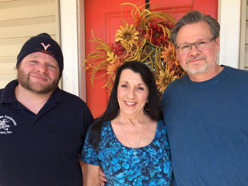 Danny McNeish, his stepmother, Julie, and his father, Phil, on the front porch of Julie and Phil's house in Roanoke, Va.