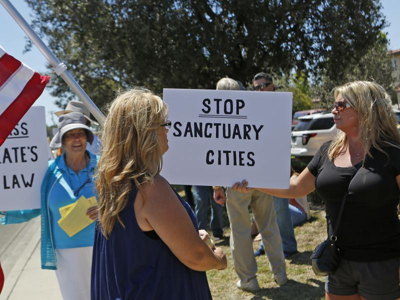 Carmen Spoerer, right, rallies among others protesting against sanctuary cities near the Santa Maria courthouse in Santa Maria, Calif. on Aug. 13.