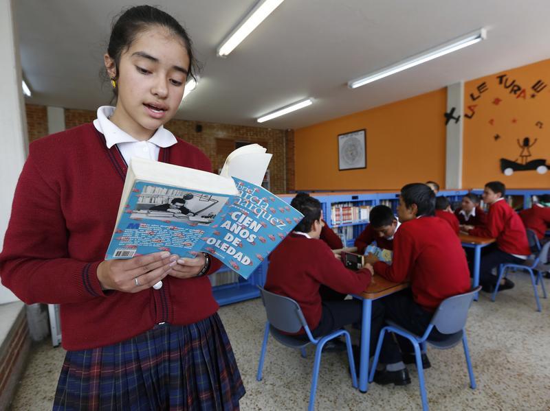 A student reads aloud from Gabriel García Márquez's <em>One Hundred Years of Solitude</em>, or <em>Cien Años de Soledad</em>, in Bogota, Colombia.