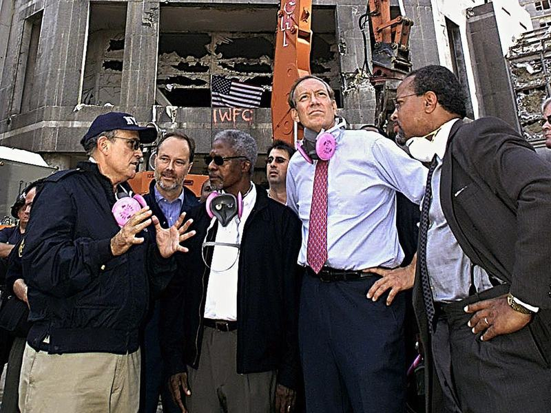 New York Mayor Rudy Giuliani (from left) gives a tour of the World Trade Center site to U.N. Secretary-General Kofi Annan and New York Gov. George Pataki a week after the Sept. 11, 2001, attacks.