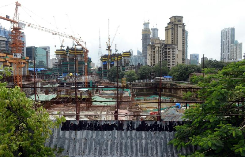 """A general view of the construction site of the luxury apartment block The Park, also dubbed """"Trump Tower,"""" in Mumbai, India, on July 31, 2015. The development is not owned by President-elect Donald Trump, but bears his name under a license agreement. (Indranil Mukherjee/AFP/Getty Images)"""