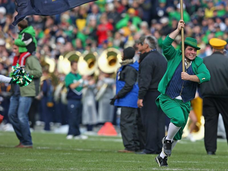 The Notre Dame Leprechaun mascot runs onto the field before a 2013 game between the Fighting Irish and the Navy Midshipmen at Notre Dame Stadium in South Bend, Indiana. Notre Dame defeated Navy 38-34. The school has been ordered to vacate all its victories that season, as well as those in the season before.