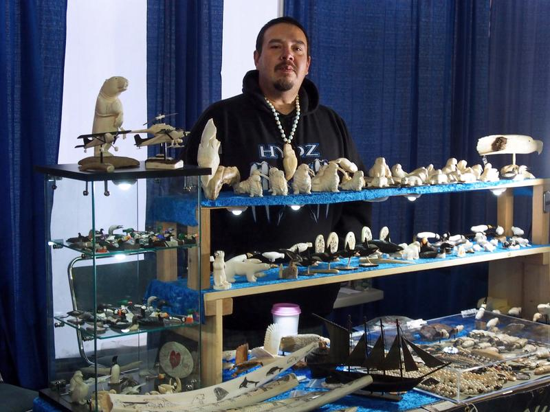 Dennis Pungowiyi sells his ivory carvings at a craft fair during the annual Alaska Federation of Natives conference.