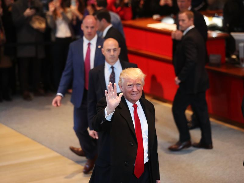 President-elect Donald Trump walks through the lobby of the New York Times following a meeting with editors at the paper on Tuesday in New York City.