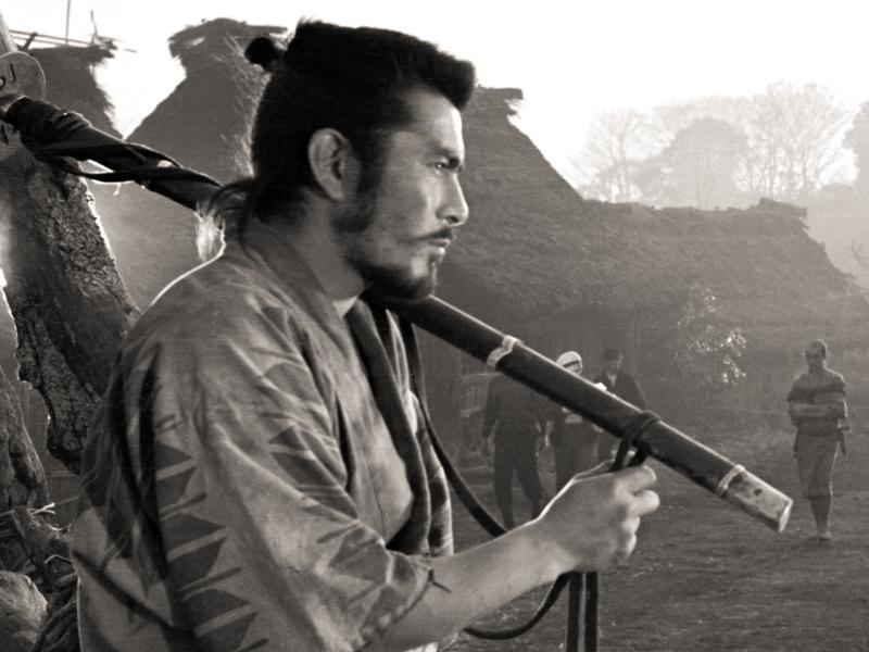 Movie star Toshiro Mifune and director Akira Kuroswa on the set of <em>Seven Samurai.</em>