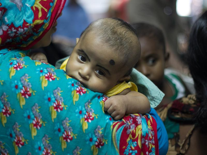 "A patient is pictured at a camp for diarrhea patients in Dhaka, Bangladesh. Among the past nominations for untold story: the need for vaccines to prevent ""severe, deadly diarrhea"" in this part of the world."