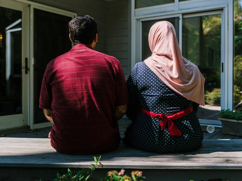 Osama and Ghada sit on the deck of their home in Princeton, N.J. They and their children are refugees from Syria and have been resettled with help from the Nassau Presbyterian Church.