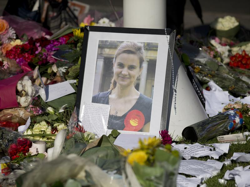 A photograph of Jo Cox, the 41-year-old Labour lawmaker who was fatally shot and stabbed in June, was among tributes in London's Parliament Square following her death.