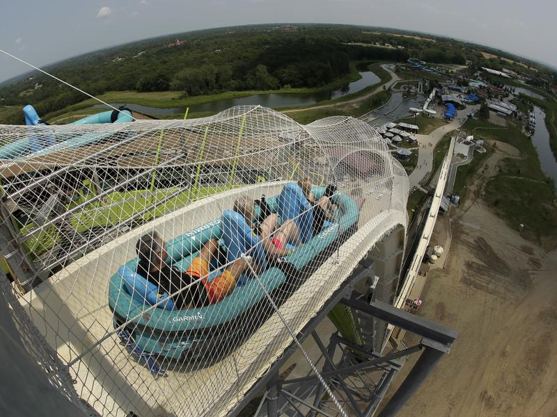 """In this photo taken with a fisheye lens, riders go down the world's tallest water slide called """"Verruckt"""" at Schlitterbahn Waterpark in 2014."""