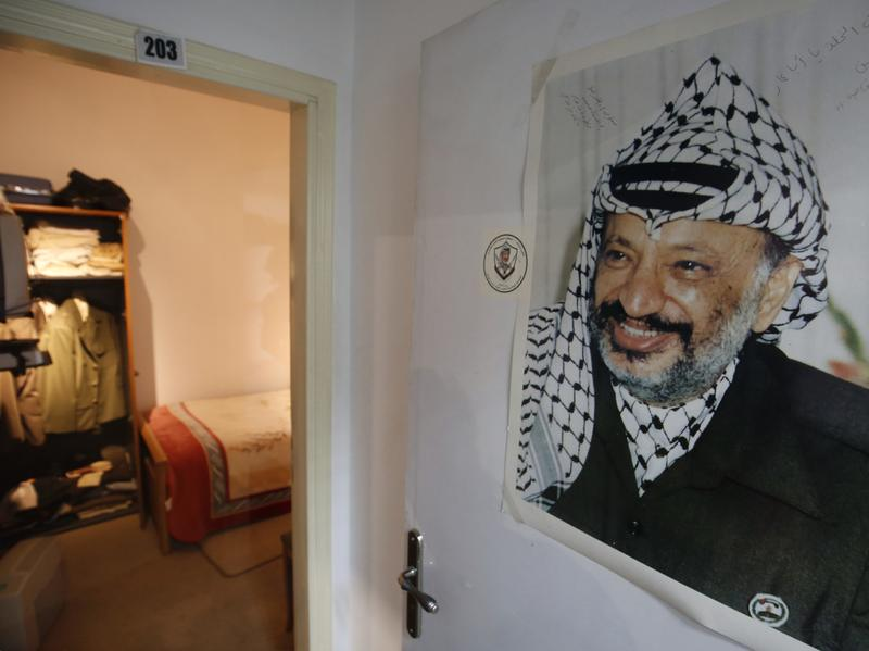 A photograph of the late Palestinian leader Yasser Arafat hangs outside a door leading to the small bedroom where he spent his final years, a display at the new Arafat Museum in the West Bank city of Ramallah.