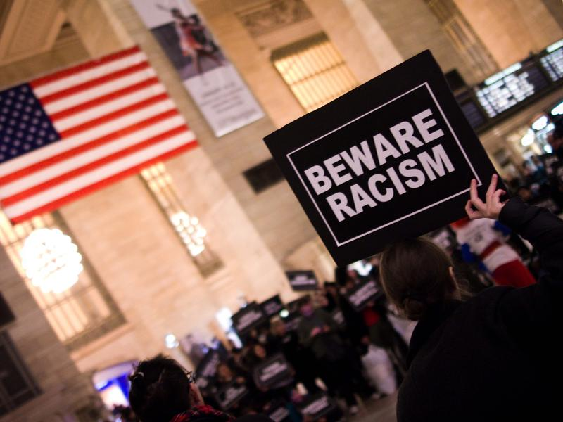 """A """"beware racism"""" placard seen in New York's Grand Central Station. Is that racist?"""