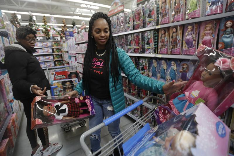 Tiffany Davis, left, and Choisette Hargon, both of Paterson, N.J., shop for toys ahead of Christmas at a Wal-Mart in Teterboro, N.J., in October 2016. (Julio Cortez/AP)