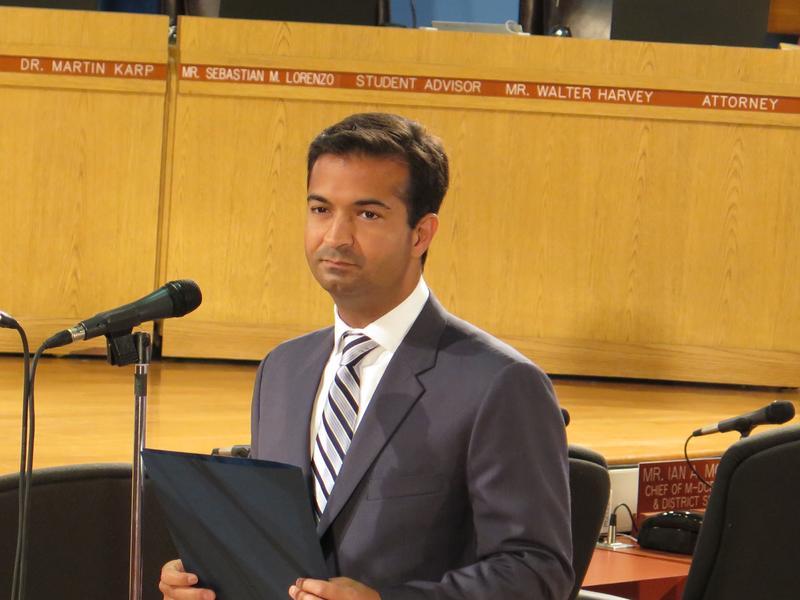 Republican Rep. Carlos Curbelo prepares to speak at a Miami-Dade County school board meeting. Curbelo began his political career on the school board.