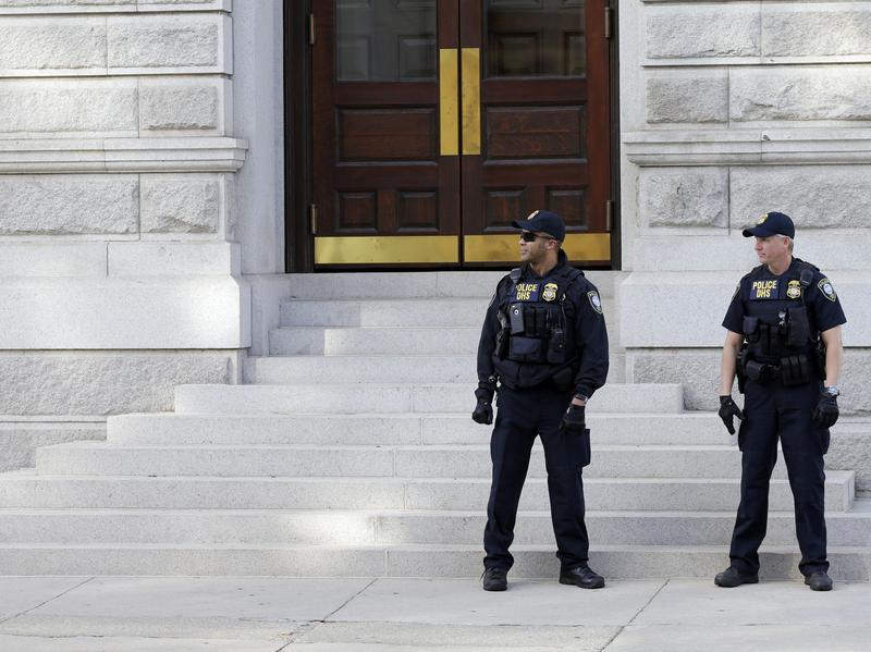 Officers with the Department of Homeland Security patrol outside the federal courthouse in Charleston, S.C., on Nov. 7.