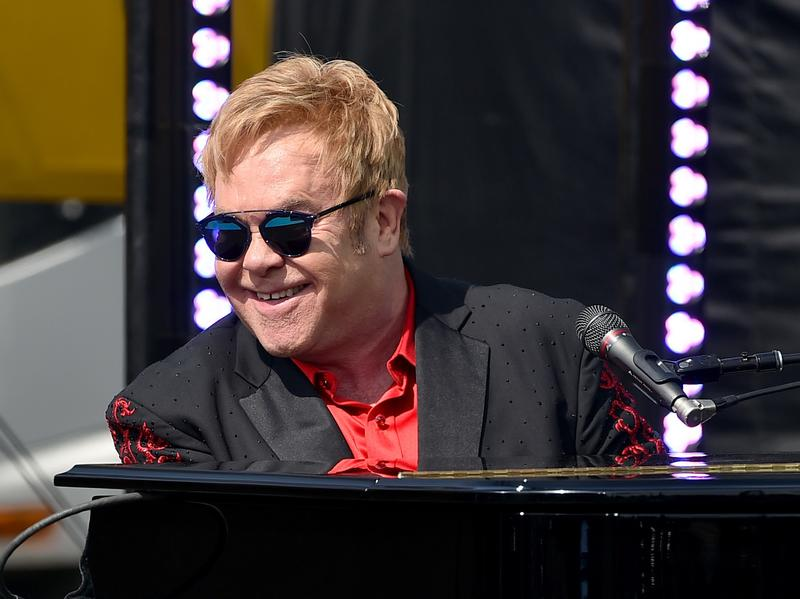 Elton John offered free tickets for his concert to Canadian border guard after the guard helped the singer get through customs. The guard wasn't supposed to accept the tickets, but he did and was then suspended.