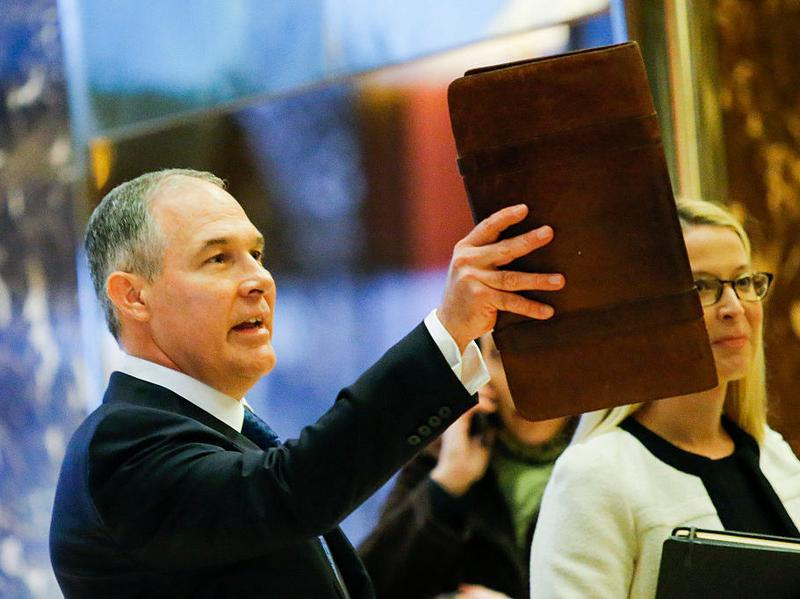 Oklahoma Attorney General Scott Pruitt arrives for meetings with President-elect Donald Trump at Trump Tower in New York City.