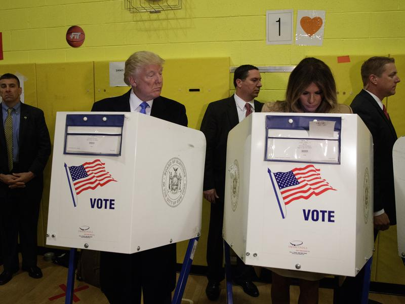 Republican presidential candidate Donald Trump looks at his wife, Melania, as they cast their votes at P.S. 59 in New York on Election Day.