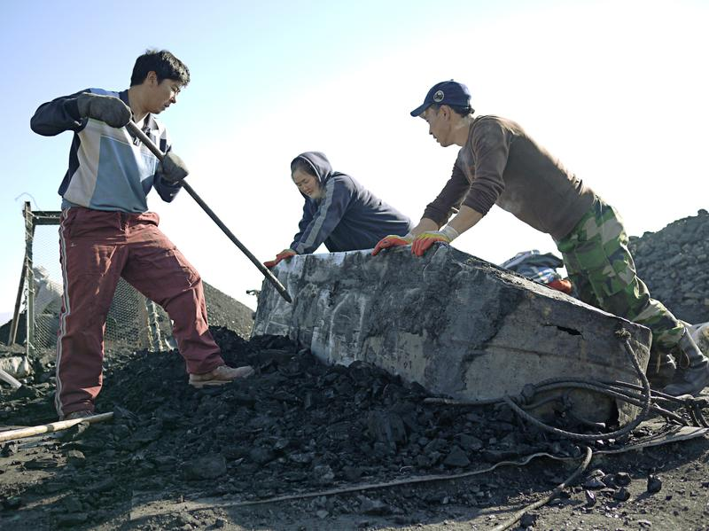 A coal mining brigade unloads a cart full of coal that has been freshly mined from half-a-mile below the surface of the earth. For some rural Mongolians, risking their lives in crude, makeshift mines is the only way to survive.