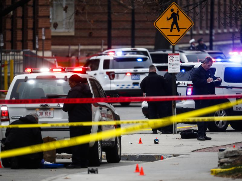Crime scene investigators collect evidence following an attack on the campus of Ohio State University in Columbus.