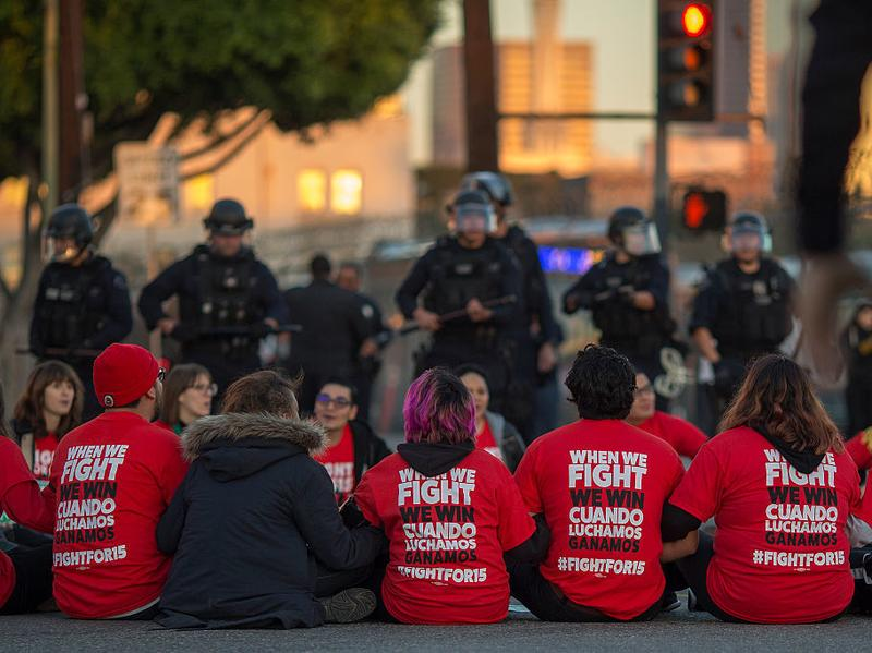 "Police surround McDonald's restaurant employees who were sitting in an intersection in Los Angeles after walking off the job to demand a $15 minimum wage and union rights during nationwide ""Fight for $15"" protests on Tuesday."