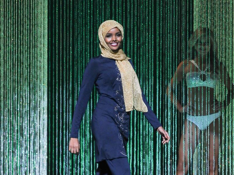 Halima Aden wore a navy blue, embroidered burkini — a full-body bathing suit — during the swimsuit competition.