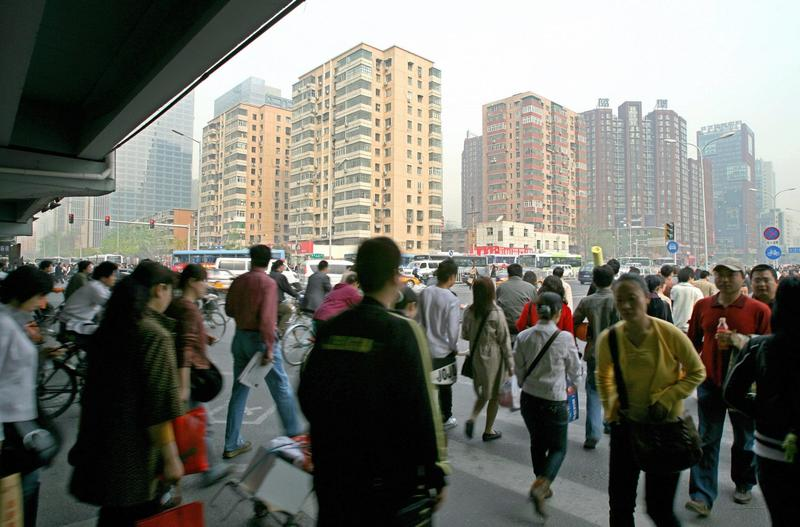 A busy street scene shows a crowd of people rushing to work in central Beijing, April 19, 2007. Beijing's local government is among the three dozen beginning to collect data to rate creditworthiness. (Teh Eng Koon/AFP/Getty Images)