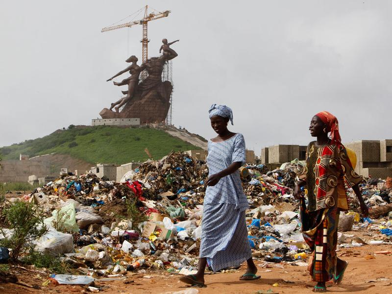 Women walk past the African Renaissance Monument near Dakar, Senegal, in 2009, shortly before it was finished by North Korean workers. Critics complained about the $27 million cost.