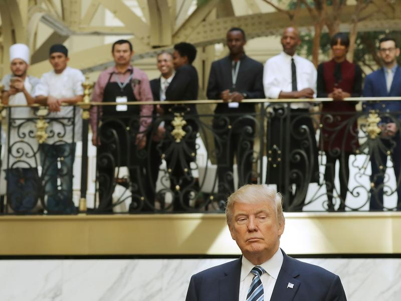 Hotel employees watch Donald Trump following a ribbon-cutting ceremony at the new Trump International Hotel on Oct. 26 in Washington, D.C.