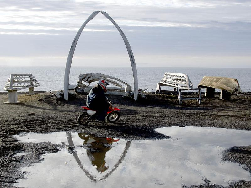 A resident of the town formerly known as Barrow, Alaska, rides her motorcycle along an Arctic Ocean beach in 2005. The town is now officially called Utqiagvik, its Inupiaq name.