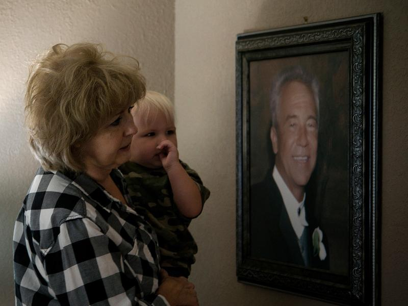 Ellen Bethea and her great-grandson, Lucas, look at a painting of her late husband, Archie.