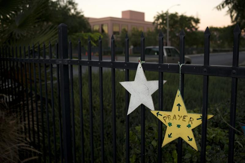 In this Nov. 18, 2016 photo, the Inland Regional Center building where the Dec. 2, 2015, terror attack took place is visible in the background behind star-shaped memorial pieces in San Bernardino, Calif. (Jae C. Hong/AP)