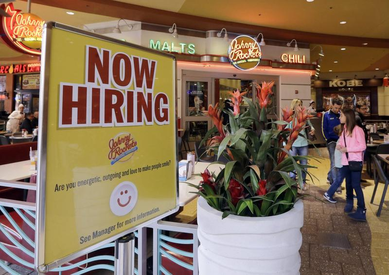 In this Feb. 9, 2016 file photo, a restaurant posts a sign indicating they are hiring, in Miami. (Alan Diaz/AP Photo)