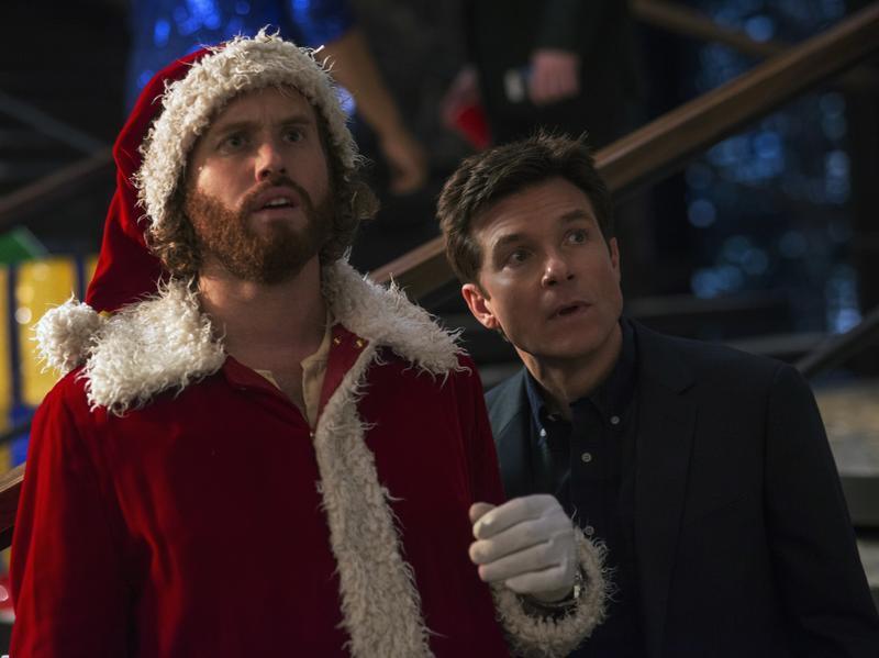 (Left to right) T.J. Miller as Clay Vanstone, Jason Bateman as Josh Parker in <em>Office Christmas Party.</em>