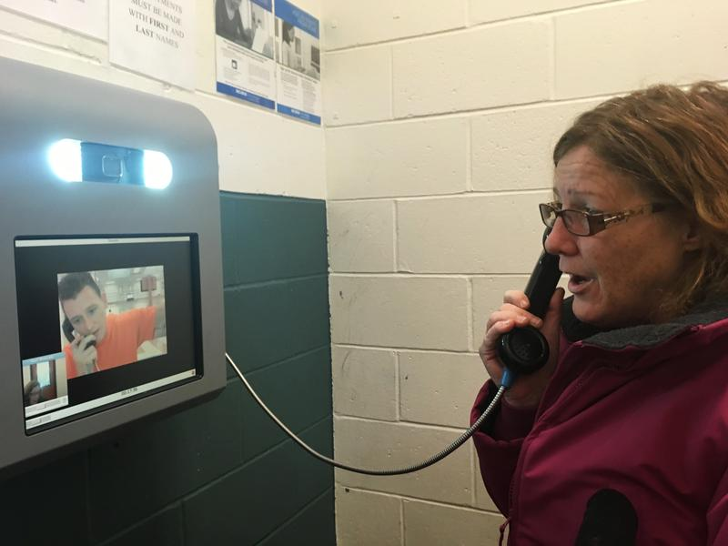 Dawn Herbert visits with her son Tommy Rogers via video call at Cheshire County Jail in Keene, N.H.