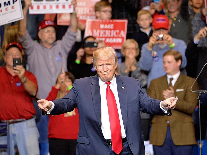 """President-elect Donald Trump points to his supporters during his """"Thank You"""" rally in Fayetteville, N.C., on Tuesday night."""