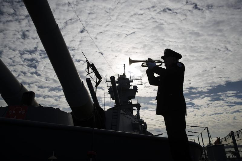 Greg Murphy plays the Navy Hymn during a ceremony commemorating the 75th anniversary of the Dec. 7, 1941 Japanese attack on Pearl Harbor, on board The Battleship New Jersey Museum and Memorial in Camden, N.J., Wednesday, Dec. 7, 2016. (Matt Rourke/AP Photo)