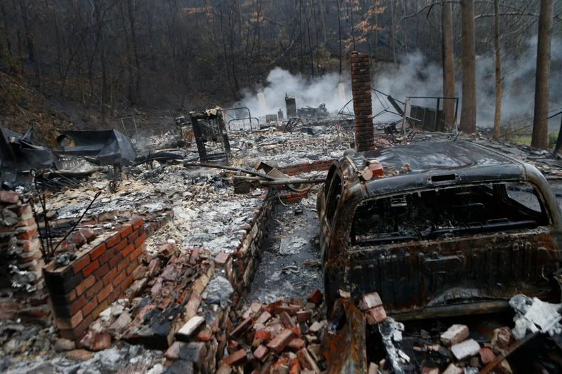The remains of a home smolder in the wake of a wildfire Nov. 30, 2016 in Gatlinburg, Tennessee. (Brian Blanco/Getty Images)