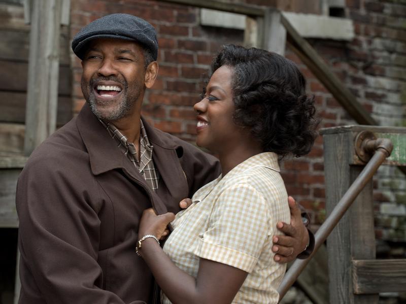 Denzel Washington as Troy Maxson and Viola Davis as Rose Maxson in <em>Fences</em>