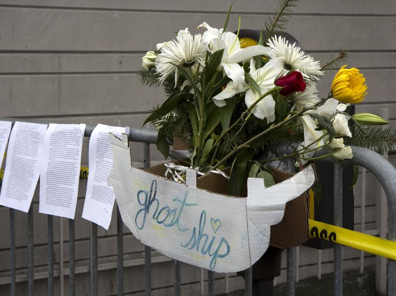 """Flowers, letters, and handmade signs were left as a memorial to victims of the fire at the artists' collective known as """"Ghost Ship."""""""