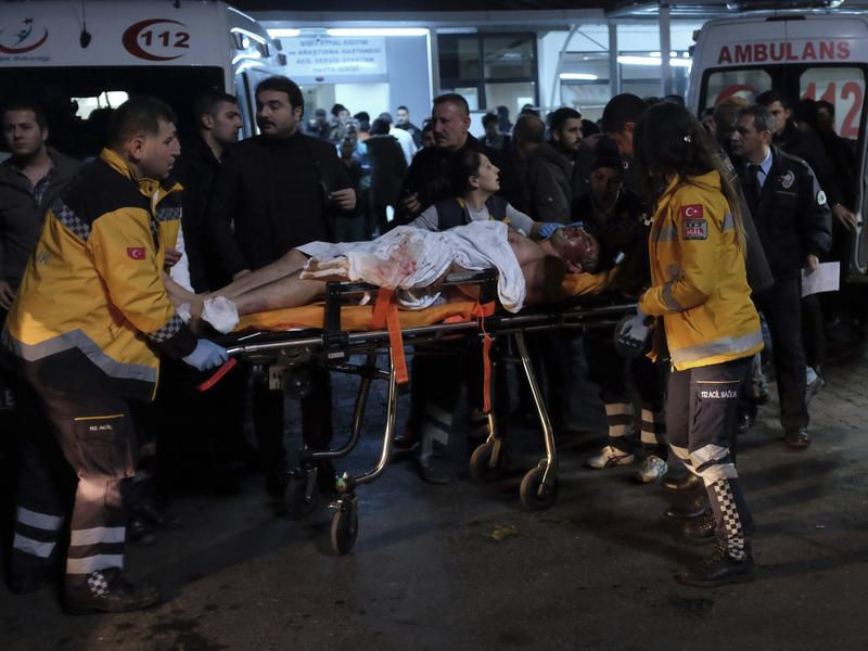 Rescue and medics carry a wounded person after attacks in Istanbul, late Saturday. Two explosions struck outside a major soccer stadium in Istanbul after fans had gone home.