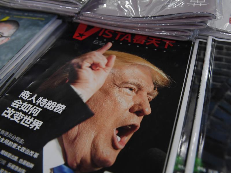 "A magazine featuring U.S. President-elect Donald Trump is seen at a bookstore in Beijing on Monday. The headline reads, ""How will businessman Trump change the world?"" Beijing is ""seriously concerned"" by Trump's suggestion that he could drop Washington's one-China policy, officials said Monday."