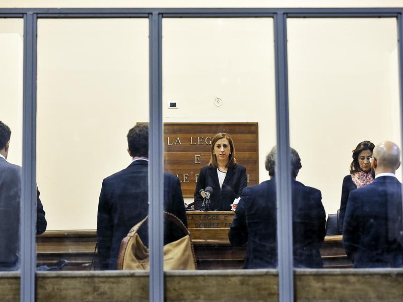 Judge Daniela Monaco Crea reads the sentence on Tuesday in the trial against ship captain Mohammed Ali Malek and crewmate Mahmud Bikhit in the April 2015 shipwreck off Libya that killed 700 people.